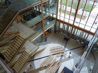 commercial timber frame atrium UBC glu-lam timbers floating stairs
